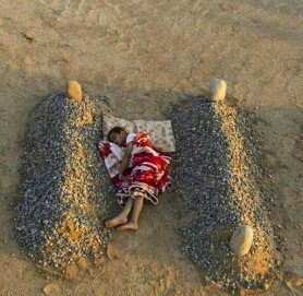 "Orphaned Syrian Boy Sleeping Between his Parents' Graves. The photo, as captioned, tugged at the heartstrings. So it was no surprise that it quickly went viral. But it was soon revealed to be a staged shot taken by a photographer in Saudi Arabia as part of a conceptual art project. The graves were fake, and the boy was the photographer's nephew. The photographer, 24-year-old Abdel Aziz Al-Atibi took the photo of his nephew Ibrahim on January 3, 2014. He then posted it to his Instagram account, with the message, ""Some kids might feel that their dead parents' bodies are more affectionate to them than the people they're living with."" He later explained to beirut.com: ""I'm a photographer and I try to talk about the suffering that is happening in society, it's my hobby and my exaggeration is intended to deliver my idea."" The image quickly went viral, but as it did so people assumed it showed a child whose family had been killed during the conflict in Syria. And it quickly gained a caption to that effect. When Al-Atibi learned of how the photo was being misunderstood, he uploaded more photos showing other shots of his nephew during the photoshoot, to demonstrate that the scene was a staged art project. http://hoaxes.org/photo_database/viral_images"